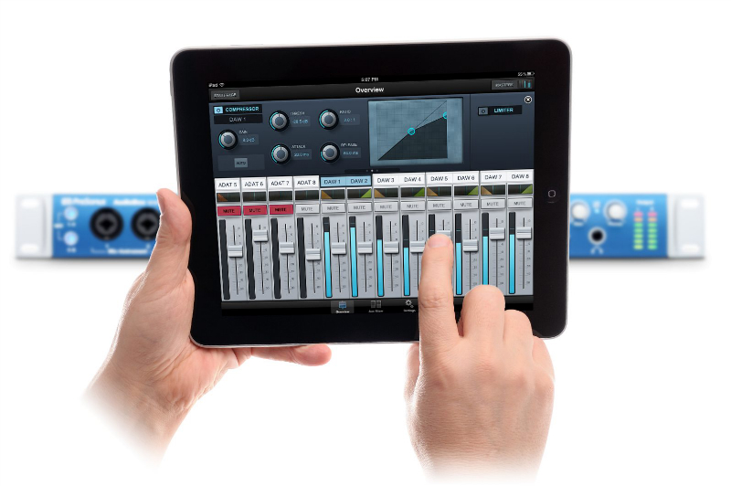 Image of a person using the Presonus AudioBox 1818VSL Remote software on an iPad with an AudioBox 1818VSL unit in the background.