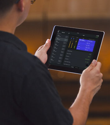 Photo of someone using the ShurePlus app on their iPad.